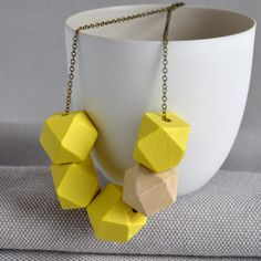 Bold yellow and natural wooden bead necklace, handmade in Ireland. Wooden Bead Necklaces, Wooden Beads, Stone Street, Bold Fashion, Handmade Jewellery, Woodcarving, Brass Chain, Bright Yellow, Winter Wardrobe