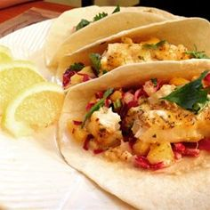 "Easy Fish Tacos with Mango-Pineapple Slaw | ""These tacos were AMAZING! """