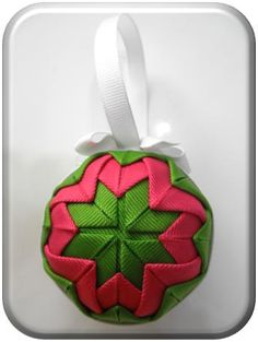 DIY Ribbon Ornament - love the bold yet pretty effect of the folded and layered grosgrain ribbon.