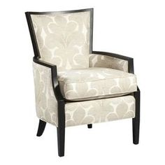 Upholstered arm chair with wood trim. Made in the USA.  Product: ChairConstruction Material: Wood and rayon polyester blendColor: Black and beigeFeatures:  Transitional styleMade in the USA Dimensions: 38.5 H x 27 W x 30 D