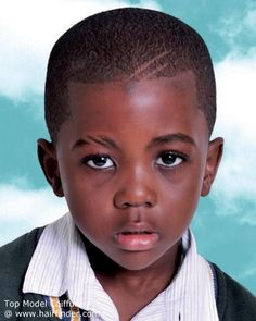 Young Black Boy Sporting A Mimimeter Short Buzz Cut With Lines Shaved Into The Hair And Eyebrow