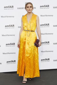 Olivia was shining bright in the city of lights with her elegant marigold Dior gown and pearl embellished accessories.