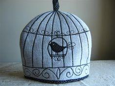 Embroidered Birdcage Tea Cosy. via Etsy.