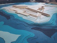 Landscape topography bathymetry model, blue gradient papers / Floyd Bennett Field, Brooklyn, NY / Reticulating Runways  by Sabrina Wang, Chris Tomasetti