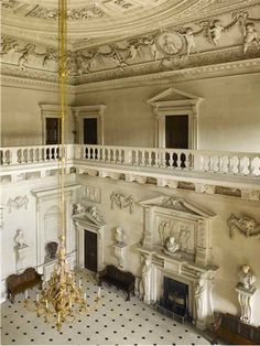 The Stone Hall at Houghton Hall. The plasterwork on the ceiling and in the cove is by Guiseppe Artar. The furniture consists of just the original six benches and two side-tables. The gilt chandelier was acquired by the 2nd Lord Orford in 1748 at the sale of the London house of his brother-in-law, 3rd Earl of Cholmondeley.NorfolkEngland...  From...  http://a-l-ancien-regime.tumblr.com/#