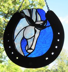 Stained glass horse suncatcher created by Janice Finn Culp.