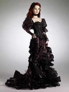 """TONNER 2012  American Models  BELLADONNA  Outfit Only - LE200  Fits 22"""" American Models™  Black puffed sleeve corset with ribbon, velvet and embroidery trim  Black satin skirt with side front slit trimmed with chiffon, lamé, lace and net  Black embroidered, beaded head piece  Ribbon necklace  Black lace gauntlets  Black fishnet stockings  Note: Shoes not included    Your Price: $189.99"""