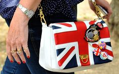 A woman carries a Union flag handbag in London