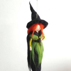 Halloween decor, Needle felt doll, Art doll, Needle felt, Witchy, Fantasy decor, Witch decor, Halloween witch decor, Witch doll, Felt witch  A needle felt art doll witch for Halloween.This needle felt witch is wearing a green and black dress. She has red-orange long hair has the mandatory pointy black hat and long black cloak on.
