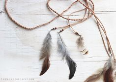 When I saw this boho feather headwrap over at Urban Outfitters, I knew I could create something similar! I'm a big fan of festival inspired accessories (especially ones with feathers) and this would be perfect for any summer event! If you want to make one too, here is what you will nee