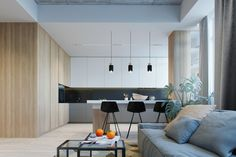 The view to the kitchen offers a different perspective. Three black chairs pair…