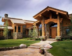 Log Cabin Mansion! Love the rocks and huge logs instead of columns.