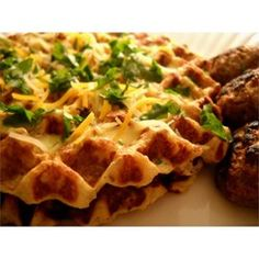 These savory potato waffles are similar to potato pancakes, but in waffle form. The batter consists of onion, garlic, and mashed potatoes cooked until golden brown in your waffle iron. Serve with fish or chicken and sauteed apples.