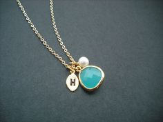 16K yellow gold Hand stamped personalized initial necklace - aqua blue bezel glass. $18.00, via Etsy.