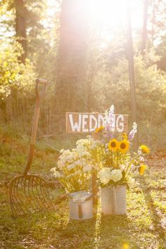 rustic wedding details: wedding sign with floral in galvanized buckets and pitch fork