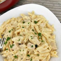 One Pot Cheesy Chicken Alfredo with Skinless Chicken Breasts, Salt, Pepper, Italian Seasoning, Olive Oil, Garlic, Chicken Broth, Heavy Cream, Penne Pasta, Dried Basil, Grated Parmesan Cheese, Mozzarella Cheese.