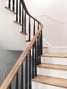 Stewart-Schafer finished the existing staircase and railings by hand. All of the spindles are painted black to give the traditional formwork a modern aesthetic. Tagged: Staircase, Wood Tread, and Wood Railing.