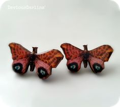 Butterfly Earrings with leopard print. Resin covered image on laser cut wood
