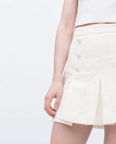 1960s-style pleated mini skirt at Zara