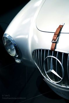 This Mercedes has a leather strap to keep the hood down.  Oh how times have changed.