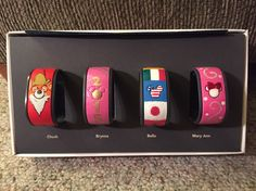 Magic Bands! Here is Robin Hood, a 2015 band, EPCOT flags, and Minnie Mouse.