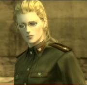 """EVA (real name: Tatyana) is a spy who plays the role of a double agent in Metal Gear Solid 3, both seducing Naked Snake and feigning loyalty to Colonel Volgin (the game's secondary antagonist).  At the end she's revealed to be working for the Chinese government and tasked with retrieving the """"Philosoper's Legacy"""" (it's complicated).  She then becomes surrogate mother to Big Boss's clones (Solid Snake and Liquid Snake) and dies during the events of Metal Gear Solid 4 as an old lady."""