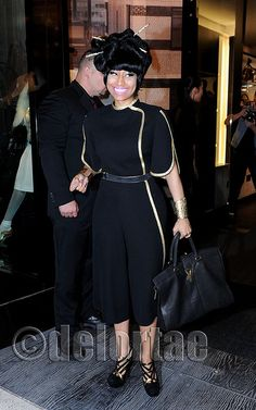 Nicki Minaj Head to Toe YSL toting Cabas Chyc Bag    Rapper Nicki Minaj spotted at the Giuseppe Zanotti boutique for Fashion's Night Out in NYC, and was wearing a YSL Dress from the Pre-Fall 2011 Collection & carrying a matching YSL Cabas Chyc Black Leather bag ($1,995)    Completing her outfit with a pair of YSL Lucy High Heel Strappy Pumps ($1,095) which feature black suede, black leather and gold leather.    *courtesy of www.facebook.com/DelortaeAgency UK's luxury authentic handbag SPA