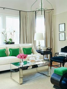 neutral living room with kelly green accents