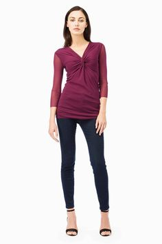 This Top has a criss-cross on the bust forming a draping in the center. Three Quarter Sleeves.