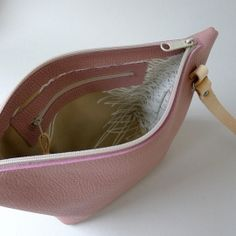 By Marieke Jacobs http://www.mariekejacobs.com/a-44984863/bags/pouch-bag-old-pink-natural-leather-silkscreened-lining/