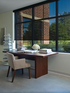 Designer screen shades are a great option for a home or commercial office.  They can be custom made with different levels of opacity.