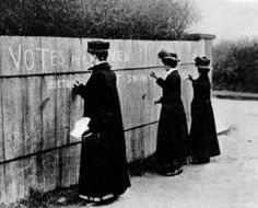 Spreading the message has been a feminist activity for a long time. Circa 1900.