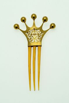 """French hairpin, crown design  Europe  France  Width : 2 3/8 inch  Height : 4 3/8 inch  Depth : 1/4 inch  Elegant blonde tortoiseshell hairpin with a royal heading. Note the """"fleur de lys"""" in the middle."""