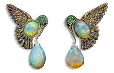 Orange Mexican opal earrings. And let me just say that opal is very beautiful