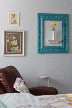 love the frame around the flower vase