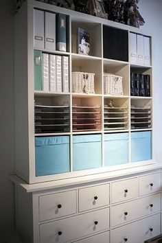 Craft room inspiration: medium sized square EPEDIT (or KALLAX) unit over a HEMNES chest of drawers, from IKEA. Add dividers for scrapbook paper.