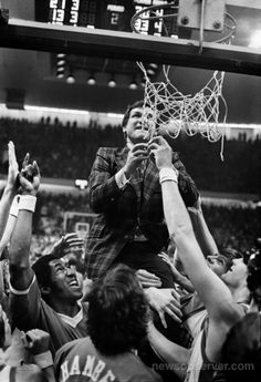 Coach Dean Smith cutting down nets after winning 1975 ACC Tournament