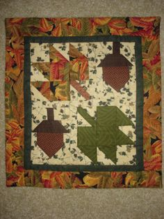 Acorn and maple Leaf Fall quilted wall hanging quilt moda fabric. $19.99, via Etsy.