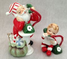 Vintage Josef Original figurine set. A small child, Christmas list in hand, is having a telephone conversation with Santa Claus.
