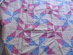 See how to make a quillow - and then fold it into a cushion. Delightful way to pack a quilt into a small package. You can turn any quilt into a quillow