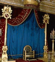 Napoleon's throne room~the velvet draperies are embroidered with golden bees.