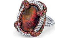 Martin Katz  - oval shaped Black Australian Red Opal, 6.48 carats. Surrounded with 234 white diamonds and held by a swirl of red and orange sapphires, tsavorite garnets and green tourmalines.