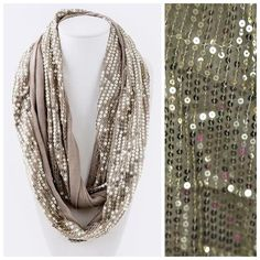 """Gold Sequin Dual Sided Infinity Scarf This scarf is so fun & beautiful!    Double sided, sequin on one side and soft fabric on the other.  This scarf with go with pretty much anything in your closet.  Dress up any outfit day or night.  Also available in other colors.  Please check my closet for many more items including jewelry & designer scarves.  100% polyester. ‼️ PRICE FIRM UNLESS BUNDLED WITH OTHER ITEMS FROM MY CLOSET ‼️  Length 36""""  Width 7"""" Boutique Accessories Scarves & Wraps"""