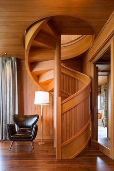 Stylish Homes - Sitting area next to a stunning spiral wood...
