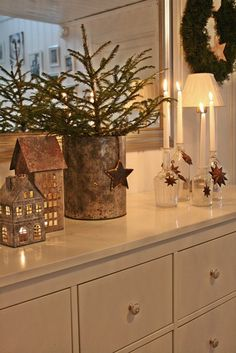 VIBEKE DESIGN: Small rusty tin houses, tree in an old crock...christmas :)