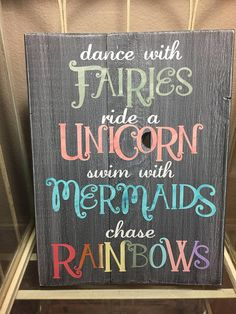 This beautiful sign is painted a distressed charcoal grey, the letters are painted in antique white and soft rainbow colors. The words Fairies is accented with champagne gold, the word Unicorn is accented with Metallic rose, and the word Mermaid is accented with metallic