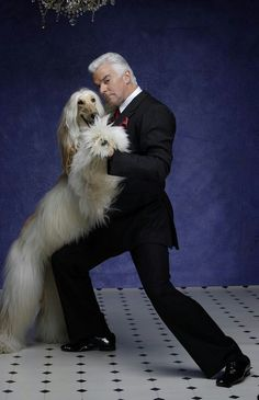 Good evening, this is a photo of J. Peterman dancing with an Afghan hound, otherwise known as THE CLASSIEST IMAGE KNOWN TO MAN.