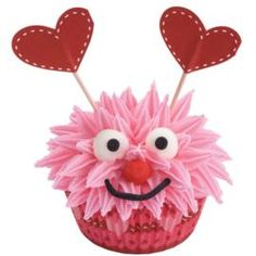 Cupcake monsters are cute and quick! Valentine Combo Pack provides the decorative baking cups and heart-shaped picks. His fur is easy to do with pull-out icing stars!