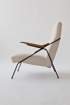 Pierre Guariche; Enameled Metal and Oak Arm Chair, 1950s. #LoungeChair