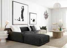 graues Ecksofa mit weißen Kissen und abstrakte Wandbilder